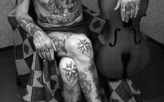 Татуировки блатных и их значение. Фразы и надписи в тюремной татуировке